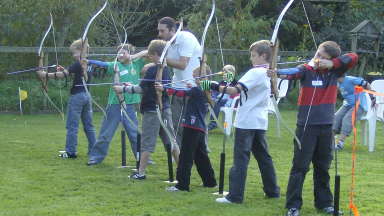 Children taught archery in group